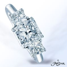 Style 0574 Diamond ring featuring a stunning radiant-cut 2.01 ct diamond embraced by princess-cut diamonds; handcrafted in platinum. #diamondring #engagementring