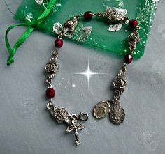 Hey, I found this really awesome Etsy listing at https://www.etsy.com/listing/261009619/vintage-silverplate-rosary-roses-red