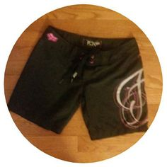 FOX BOARD SHORTS Gorgeous board shorts in black with pink design by FOX! See pics for details. Size 3 Fox Shorts