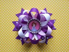 This listing is for 1 Sofia the first bow... Bow measures 4inch... Bow are available in many colors... store bows in a cool place as adhesive may loosen with extreme heat... Warning: Supervise children when wearing accessories as any accessory may pose a chocking hazard... Care