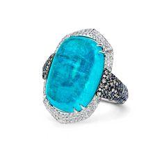 The white diamonds surrounding the Paraiba tourmaline enhance the intense blue colour of the spectacular centre stone in this Martin Katz ring.