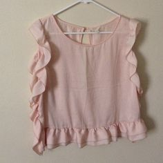 """Adorable ruffled top I so so wish this fit me, so adorable with Ruffles on all three edges and open back, will fit up to 39"""" bust, 21"""" long, please excuse the wrinkles from my overstuffed closet, lol I love H81 Tops Blouses"""