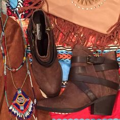 cool leather Steve Madden boots with strap New and never worn. Cool as hell boot in beautiful brown leather with wrap around a strap. Zipper opening. Wear these with skinny jeans and cool tee or with a short dress and look cool no matter what. No trades. Steve Madden Shoes Ankle Boots & Booties