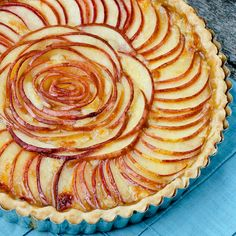 apple and brie tart. @Julie Bondy this looks somewhat familiar. I don't know if I'd have the energy to slice all those apples so thin, though!