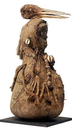 Africa |  Dan Fetish doll, Liberia | This fetish-like object has a wood wood, cloth bundle, and bird's skull