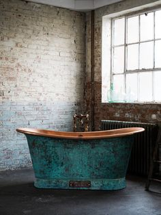 The contrast between verdigris and copper is equally suited to urban and rural properties. Bath by Catchpole & Rye