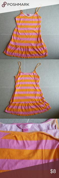 """VS PINK tank top VS PINK orange & pink striped tank top with ruffle detail at the bottom. Measures  21"""" long from chest to bottom, and 16"""" armpit to armpit. 100% cotton. Excellent condition, no stains or holes. No trades. Bundle and save! PINK Victoria's Secret Tops Tank Tops"""