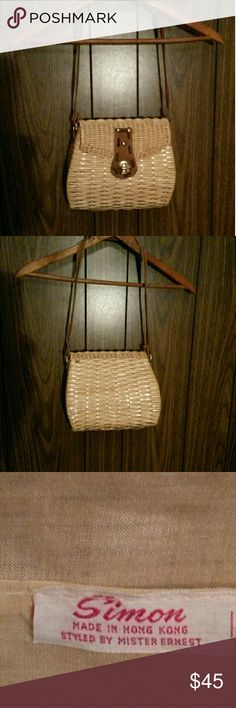 """1950's Vintage Woven Purse A """"Simon Styled by Mister Ernest"""" purse/handbag was made in the 1950's and remains in perfect, mint condition.  This vintage find is woven wicker with a brown leather trim and cotton lined interior. Simon  Bags"""