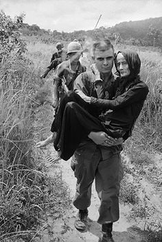 catherine leroy photos of vietnam 1966-67 | ... is carried to a hospital by a soldier, 1965, Ba Ria, South Vietnam