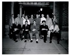 ID#0146 Date: 1956. This image shows a group of employees who received awards for their years of service as city employees in 1956.  Front row, left to right: John Fisher, Ire Venske, Jack Oldfield, Norm Schmidt,  Alvin Scott. Standing, left to right: Jack Harley, Clint Hanmer, Jim Mann, Rudy Poszgai, Chuck Bailey, Ev Coates, Bob McKinley, Kenneth Bohrer, Bob Cline. Participant: Charles Bailey. Additional Sources: Interview of Chuck Bailey, 01/23/01.