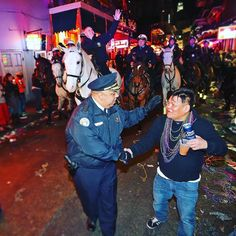YOU'RE WELCOME. GO HOME. At midnight NOPD Chief Michael Harrison with Mayor Mitch Landrieu following on horseback is thanked by a reveler during the symbolic sweep of Bourbon Street to mark the end of Mardi Gras 2016. (Michael DeMocker) #carnival #mardigras #neworleans #nola #nopd #frenchquarter #bourbonstreet by nolanews