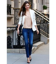 Miranda Kerr If denim is allowed at your office (lucky you!), take note of how Kerr paired her Frame Denim jeans with workwear staples like classic Manolo Blahnik pumps and a Stella McCartney blazer.  http://www.whowhatwear.com/what-to-wear-to-score-a-raise-at-work/slide2