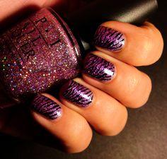 Purple glitter nails with zebra print