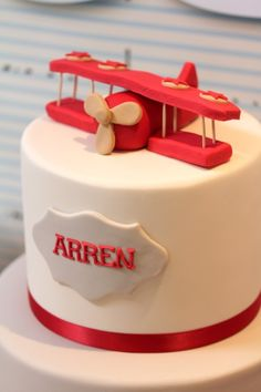 Darling Cake from this Up & Away Travel Themed 1st Birthday Party {Planning,Decor, Ideas} via Kara's Party Ideas KarasPartyIdeas.com #airplanecake #travel #partyideas