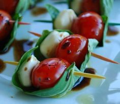 tomato and cheese wrapped in basil leaf with toothpick