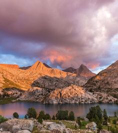 """""""This was day 16 on the John Muir Trail last summer. We had planned to hike further but this area was so stunning that we decided to set up camp after just 5 miles. It rained hailed and stormed on us four times that day. In between were pockets of sunshine sunbursts and passing thunderclouds. The dark cloud on the left showered us in hail as the side lighting of sunset lit every little piece of ice on fire. It was literally like diamonds in the sky."""" #california  Photo/caption…"""