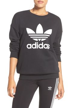This soft French-terry sweatshirt in versatile, flattering black is contrasted by an oversized adidas logo.