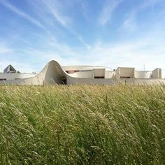 Visitors enter this nursery in northeast France through a curving concrete orifice.  The undulating entrance walls lead into a round reception room at the centre of the building.  The rest of the nursery is arranged like a human body cell, with classrooms and playrooms encircling this central nucleus.
