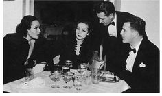 From Marlene dietrich's daughter Maria Riva's book:John Gilbert,one of the great loves of my mother's life,leaning over her shoulder.Her friends Cedric Gibbons and his wife,Dolores Del Rio——whom my mother thought the most beautiful woman in Hollywood——approved