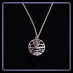 "STAR WARS NECKLACE Beautiful Star Wars necklace depicting the DEATH STAR.                                                                                                 Silver chain is ~20""    Pendant  a tad over 1"" across Jewelry Necklaces"