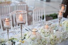 High candelabra mixed with low floral centerpiece. Wedding by Monte-Carlo Weddings