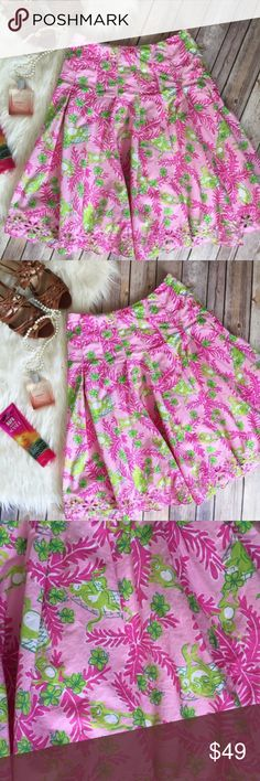 "Lilly Pulitzer pink and green eyelet skirt This is a bright and classic Lilly look! Green and pink with subtle and fun monkey print! All you need to complete this outfit is a white top and sandals!  Measurements laying flat:  * Length 23"" * Waist 13.5""  Condition/Flaws * Gently used, but still in excellent condition * No significant flaws (stains, rips, pilling)  Item # *RS7.00040.220417 Lilly Pulitzer Skirts A-Line or Full"