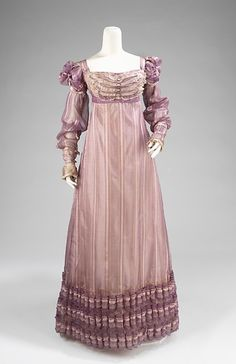 "c.1820 ""The puffed sleeves of this dress are an indication to the historicism in dress at the time. As a reinterpretation of 16th-century slashing, they make a statement about the Renaissance and the rebirth of artistic notions. The beautiful hem detail is also typical of the period spanning 1820. These details gave weight and shape to an otherwise unbroken line of fabric, which was so prevalent in the decades prior to it."""