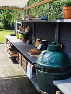 On the off chance that you are contemplating pitching your home or simply need to make a few enhancements a summer kitchen is an incredible method to do both. Including a summer kitchen isn't troublesome and the cost can expand… Continue Reading → Big Green Egg Outdoor Kitchen, Outdoor Kitchen Patio, Outdoor Kitchen Countertops, Outdoor Kitchen Design, Outdoor Kitchens, Outdoor Living, Summer Kitchen, Diy Kitchen, Kitchen Ideas