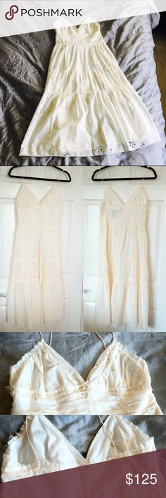 """Club Monaco Ivory Silk & Cotton Dress Club Monaco size 4 ivory dress with spaghetti straps. Floral cutout pattern, pleated detailing and raw edge hem designs. Hidden zipper and hook eye closure in back. Fully lined. Midi length on me (5'6""""). Worn once or maybe never worn at all (can't recall), so in excellent condition. Shell: 64% cotton, 36% silk. Club Monaco Dresses Midi"""