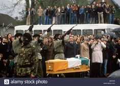 Bobby Sands funeral IRA Paramilitary shooting over coffin. Belfast Ireland 1981 ...P