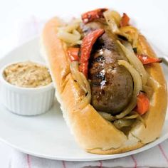 Easy crock pot beer brat sandwiches recipe. Brats are kind of pork sausages that originates from Germany. Bratwurst sausages cooked in beer together with mushrooms,bell peppers and onions,served in buns-this sandwiches hard to beat.
