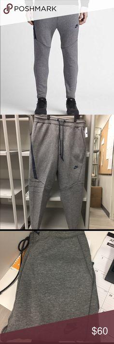 Nike tech sweat pants Nike tech fleece cropped /tapered pants/ never worn /size m/ side zip pocket with navy blue trim Nike Pants Sweatpants & Joggers