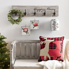 Turn your entryway into a Christmas display in a few simple steps: 1. Hang ornaments or wreaths from your coat hooks. 2. Toss Christmas themed throw pillows on your entryway bench. 3. Create a warm glow with our snowflake lantern.