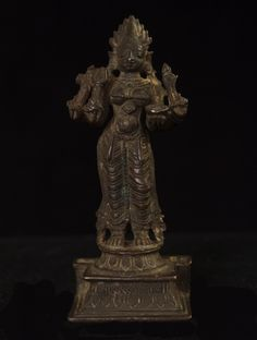 """Asian Tribal Art - Kali. 3 3/8"""" (8.5 cm) high. 18th century. Kali is the symbolic destroyer of evil and the Goddess of Time and Change.  She is worshiped to remove negative tendencies, which hinder spiritual progress and material prosperity. Here she stands with four arms holding a trident, a battle-axe, a lotus and a bowl or skullcap. She has small tusks carved on her mouth and her hair rises in flames.  #3512  $650"""