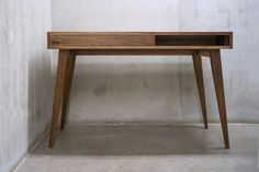 This modern billing desk is designed with simplicity in mind and carefully hand-crafted with high quality solid black walnut (picture shown) or