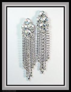 Fabulously sparkly waterfall earring shoulder dusters feature all Swarovski crystal with Rivoli-cut stones as the focal point - by Bryan Greenwood of Crystal Countess / Jewellery by Greenwood Design