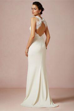 We love this open lace back. Simple yet elegant | #weddingdress