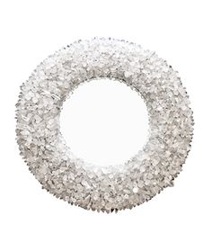 Circular wood frame with a painted silver finish, dressed with rough-cut quartz crystals