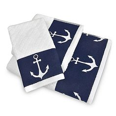 Transform your bath with the chic nautical style of Lamont Home's Anchors Away Bath Towel Collection. Soft and absorbent, each luxurious white towel boasts a sophisticated diamond pattern and a navy border accented with white anchors.