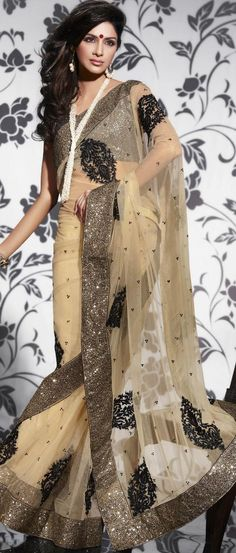 Dark Beige Net #Saree With #Blouse Shop Now @ http://www.utsavfashion.com/store/sarees-large.aspx?icode=sxk535