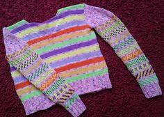 Pulli aus Baumwollgarnen mit viel Muster gestrickt.