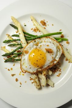 Grilled aspargus served with a crispy duck egg and broiche gremolata.