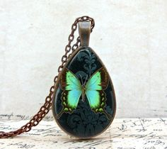 I got this - It is awesome!  Glow Butterfly Necklace Tear Drop Shape Glass Dome by KaDishDay
