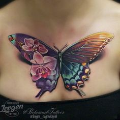 Stunning butterfly tattoo on chest by Levgen