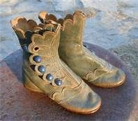 Antique leather high top baby boots green leather blue buttons.