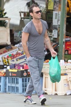 Jude Law went shopping recently in this shirt. | Jude Law Wears Deepest V-Neck Ever To Be Seen In Public