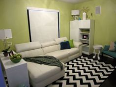 Benjamin Moore – Pale Avocado 2146-40 – This colour has a yellow base even though it looks green. It's a warm delicious colour that looks amazing without being too overpowering. Love it with the white couch and chevron black and white rug. PA