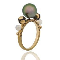 Tahitian pearl surrounded by meenakari beads & white opal, on an 18ct gold band set with pink & yellow diamonds