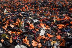 Thousands of discarded life vests are dumped in a valley in hills above Mithymna, Greece, on March 27, 2016. New boat arrivals on the island have reduced to almost zero over the last few days, but it remains unclear whether that is due to the windy weather or the deal between the EU and Turkey. Dan Kitwood / Getty.
