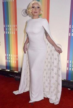 3967cb1e6587 Lady Gaga Evening Dress - Lady Gaga looked every bit the diva in a white  Valentino